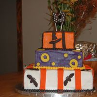 Halloween Birthday Cake This was my first attempt at fondant. I had a hard time keeping the BC smooth. Seemed like every time I put on a piece of fondant the BC...