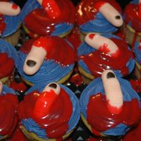 Fondant Finger   Fondant fingers, buttercream icing, and red white chocolate ganache. We loved these.