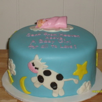 Cow Jumped Over The Moon 2 layer totally covered in fondant. This was my first attempt at covering a cake with fondant.