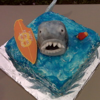 Shark Attack Made this for nephew's 8th birthday pool party. Square White cake with chocolate cream filling and vanilla butter cream. Shark is dark...