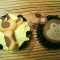 Jungle Fun! Jungle theme I did for baby shower. Animals made with MMF. First real attempt with fondant figures. Choc and Yellow cuccakes with...