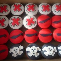 Pirate Cupcakes I had fun with these. Pirate themed chocolate peanut butter cupcakes. Fondant cut outs.