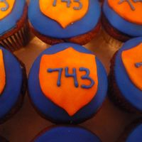 Officer Badge Cupcakes for an officer. All fondant. The 743 is his badge number.
