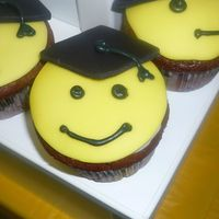 Smiley Face Graduation This was for my son's kidergarten graduation. I had to make 100 of these but they were greta. The kids loved them. All fondant tops....