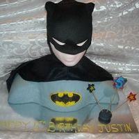 "3D Batman/bust Cake This was for my son's 5th birthday. 2 10"" chocolate and 1 8"" white for the body. The head is a wig head covered in fondant...."
