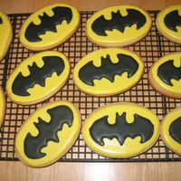 Batman Cookies These are NFSC with antonia's royal icing. I had to use a stencil to put the symbol onto each cookie so it took me a while but the mom...
