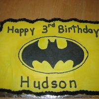 Batman Cupcake Cake This was a cupcake cake for a friend's son. I did a FBCT of the bat symbol onto yellow icing. they seemed to like it.