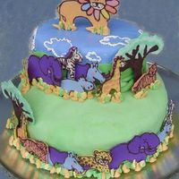 "King Of The Jungle I did this cake for my son's 2nd birthday. He was ""into"" animals then, so I did all the animal decorations out of chocolate..."