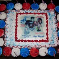 Our Hero's this cake was made for our families 4th of july celebration, the photo's are those who is now serving or has served in the military,...
