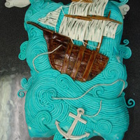 Ship Cake Made for my nephew's birthday. Found one like this on Flickr I believe. Buttercream frosted with gumpaste ship/anchor.