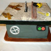 Table Saw Cake Made this for one of my husband's co-workers birthdays. He's a woodworker, and is obsessed with his table saw, so this is the...
