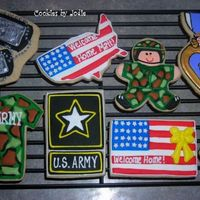 Hometown Hero... These are some of the cookies I did for a local hero coming back from Walter Reed. The dog tags are totally kneadacookie's design-...