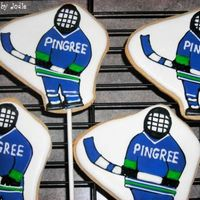 Hockey Players Cookies favors for a school's hockey team. Had to ship them so used Tracy's great tip and cut cardboard in the same shape as the...