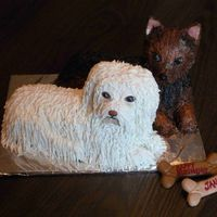 Dogs Birthday Cake  All buttercream except the ears on the brown dog are gumpaste with buttercream piped onto the back. I used a fork and paintbrush to get...