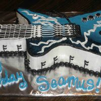 Electric Guitar Birthday  All buttercream, used a lollipop stick painted w/ black food coloring for whammy (sp?) bar. Cake was for an 11 yea old boy's birthday...