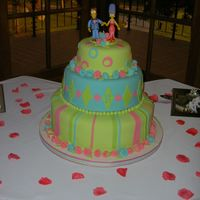 Anna's Wedding Cake! Fondant covered wedding cake in lime green, turquoise, and hot pink! Marge and Homer Simpson topped the cake, which was for a dear friend&#...