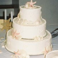 Seashore Wedding white chocolate, pearlized sea shells on a white chocolate iced cake of devils food.