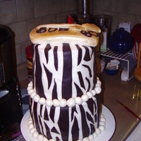 Zebra Stripe Sixtieth Birthday What a nightmare cake this was. Bottom was red velvet, but it didn't turn out quite right. The layers didn't rise very much...