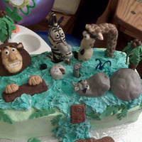 Madagascar Birthday Cake Cake is for a 2yr old's birthday. Vanilla and Chocolate cake with vanilla buttercream frosting. They requested a somewhat rustic cake...