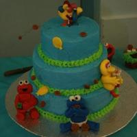 Sesame Street Baby characters are made of fondant (will use gumpaste next time around). Cake was made for a 1st Birthday Party. Buttercream frosting and...
