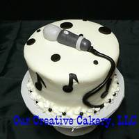 Microphone Cake Vanilla sour cream cake with butter cream icing. Gumpaste microphone and choc. fondant notes and cord