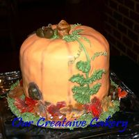 Pumpkin With Mice Practice pumpkin. Yellow cake with Irish Cream Filling (used what I had on hand). Fondant icing gumpaste leaves and mice. Thanks for...