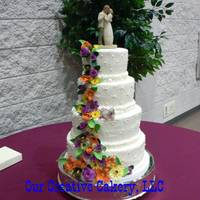 Fall Wedding Cake Buttercream cake with gumpaste flowers, and a small dog on middle tier.