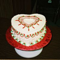 Heart Cake This was my 3rd cake I decorated...Love doing this one..Used buttercream icing and transfer Heart from waxpaper
