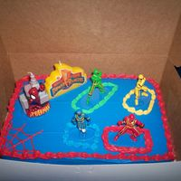 Spiderman/power Ranger Cake? Our nephew couldn't decide which he wanted a spiderman cake or a power ranger cake. My solution... both.