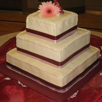 "My First Wedding Cake Well its done, my first wedding cake. 16"", 12"", 8""-- Top & Bottom are white chocolate with strawberry BC, middle is..."