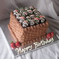 Chocolate Strawberry Birthday Chocolate cake with whipped white chocolate ganache filling, chocolate buttercream and chocolate dipped strawberries.