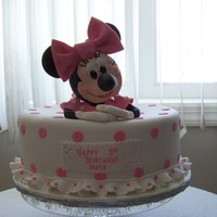 Minnie Mouse Birthday Cake This cake was for a 1-yr old girl. Minnie Mouse was made out of cake and Rise Krispie treats - her head, arms and legs were Rice Krispies....