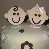 Baby_Shower_003.jpg Twin baby faces made out of fondant.