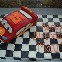 "Cars Cake  I did this for my nephew's 2nd birthday party. The car was made from two 9x13 "" pans and then I just started cutting away. Thanks..."