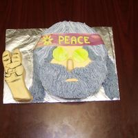 Hippie / Jerry Garcia   Cake for my boss' 60th b-day...He was a true hippie! Cut from a half sheet cake pan.