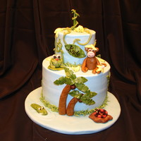 Monkey And Friends This is a first birthday cake. The decorations are all gumpaste. The cake is a banana cake with caramel buttercream filling and regular...