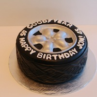 "Car Tire I made this cake for a car lover. It's a 9"" chocolate cake with chocolate ganache filling, vanilla buttercream covered with black..."
