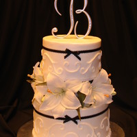 55Th Anniversary This cake was decorated with silk lilies provided by the customer that are like what the bride carried in her bouquet 55 years ago. It was...
