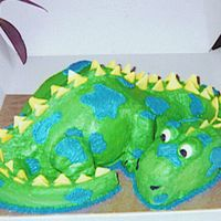 Dino Cake! I used two 8-inch rouds to make this cake. i cut one in half, stacked it, and then placed it on its side for the body, just cut up the...