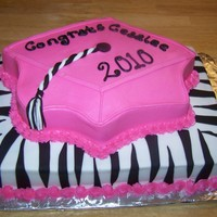 Zebra Graduation 1/2 sheet bottom layer, Wilton grad cap top layer. BC icing and fondant zebra stripes and tassle.