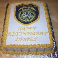 Police Cheif Retirement 1/2 sheet iced in BC, edible image scanned from uniform patch.