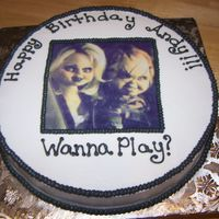 Chucky And Chucky's Bride Believe it or not this cake was for a three year old. Chucky is his favorite. I was afraid I would have nightmares after doing this cake....