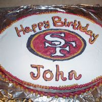 "49Er Cake Strawberry cake / BC icing. Made for my little brother's 14th B-day. Loves the niners. We teased him alot for wanting a ""pink&..."