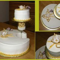 Golden Anniversary 2 tires cake, covered with butter cream icing, decorated with fondant flowers.