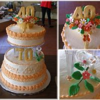 40Th Anniversary & 70Th Birthday In One Cake 3 tiers cake 8, 10, 12. Covered with butter cream icing. Inside ganache cream. Decorated with fondant flowers.