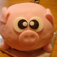 Piggy! From Carol Deacon's book: Party Cakes. It was supposed to be a piggy bank but since it was only practice I didn't go out and buy...