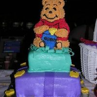 "Winnie The Pooh I did this cake for my niece's 1st birthday. 14"" square, 10"" square and 3D Pooh. MMF w/ buttercream for Pooh. I also added..."