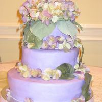 Purple Hydrangea Cake Purple Hydrangea Cake made with 12,10,6 inch round pans with marshmallow fondant and silk flowers. This was my first wedding cake.