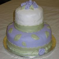 Purple And White Cake Purple, white, and sage green fondant ribbon roses cake. made with 10 and 6 inch pans and marshmallow fondant.