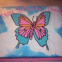 Tammy's Butterfly FBCT on chocolate fudge cake with bc icing